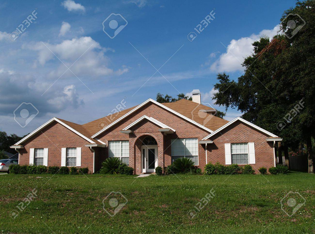 The exterior of a one story brick residential home. Stock Photo - 5580803
