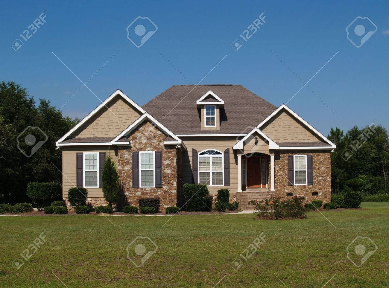 Single story stone and vinyl residential home. Stock Photo - 5681021