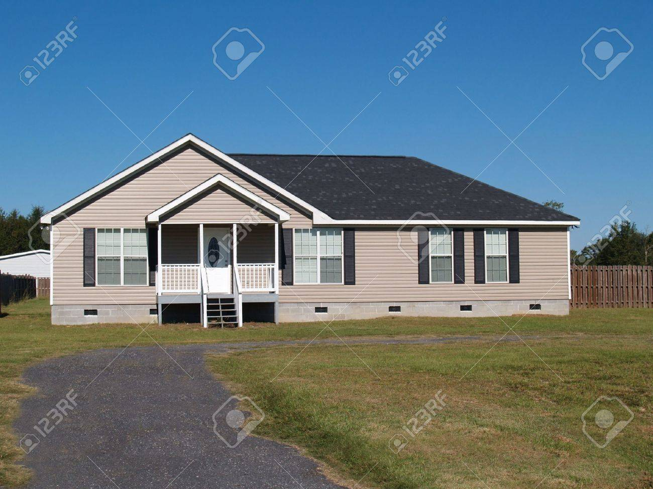 Small low income manufactured home with a covered porch and vinyl siding. - 5681020
