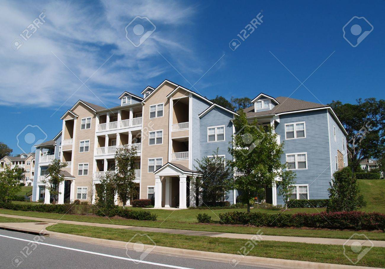 Three story condos, apartments or townhomes with vinyl siding of blue and tan. - 6386310