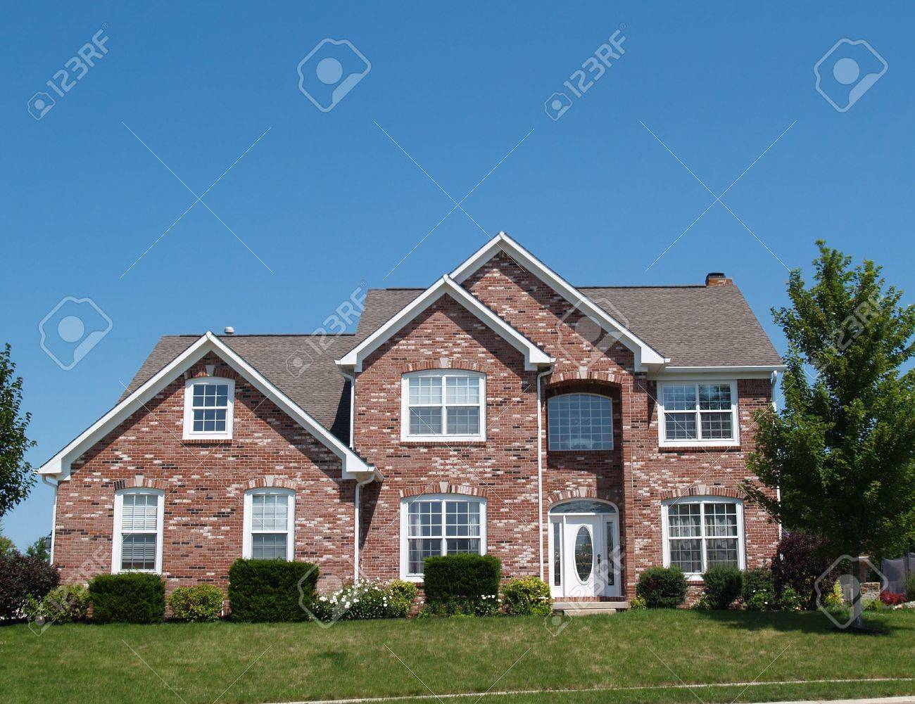 Two story new brick residential home with side garage and plenty of copy space. Stock Photo - 6448196