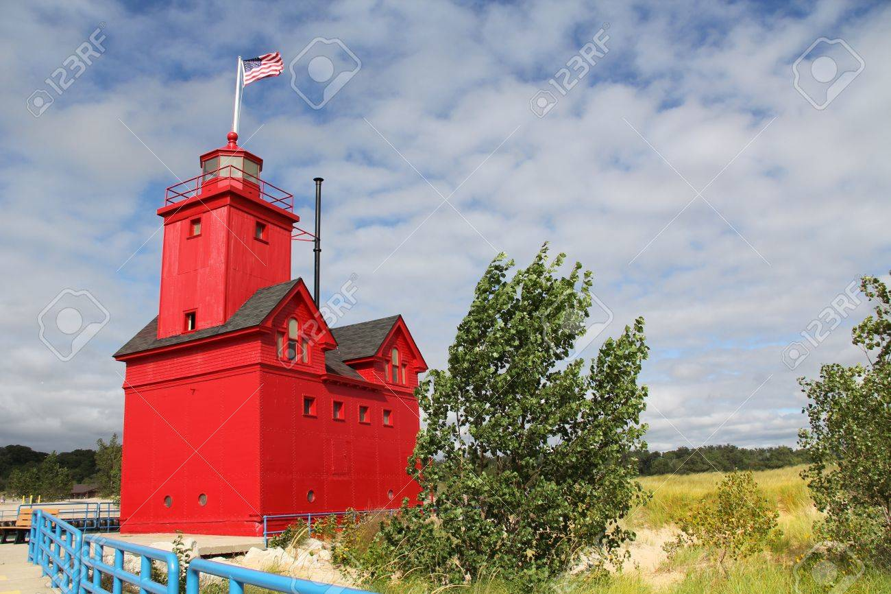 Big Red Lighthouse On The Beach In Holland Michigan With Copy
