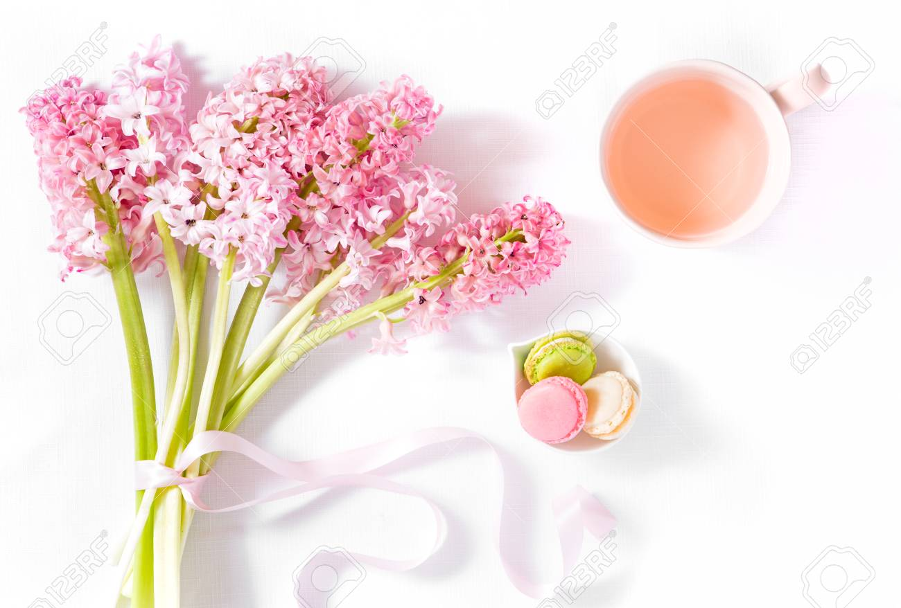 Bouquet of pink hyacinth flowers with mini macarons and rose stock bouquet of pink hyacinth flowers with mini macarons and rose tea stock photo 100368777 izmirmasajfo