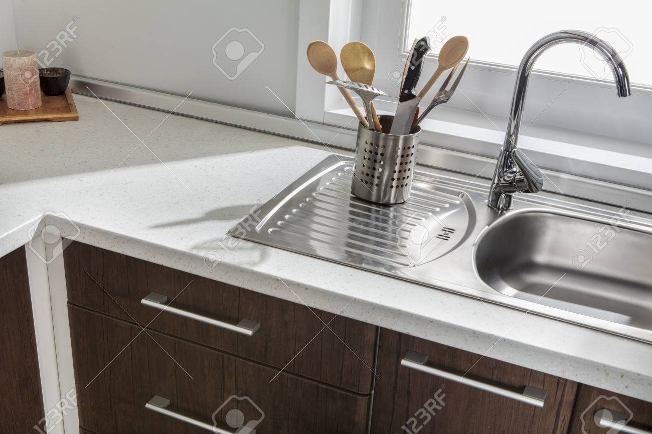 Part of modern kitchen sink with drawers and handles