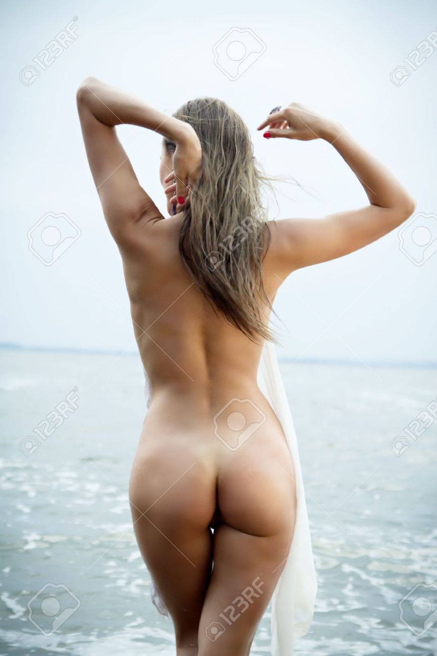 Sexy Girl With A Figure Standing At The Sea Showing Her Ass Stock