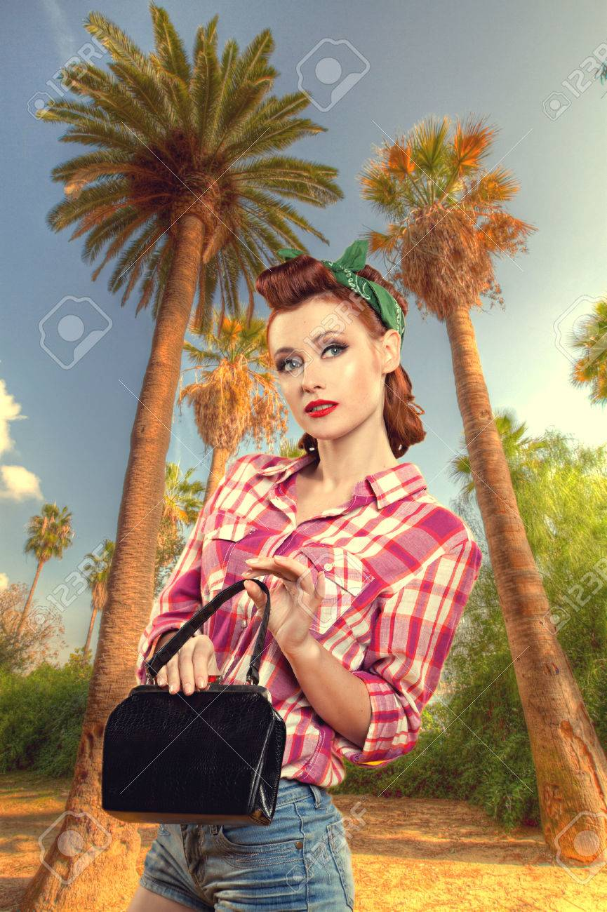 31aacf310b56 pin-up girl with a suitcase goes on vacation. Pin up vintage retro lifestyle