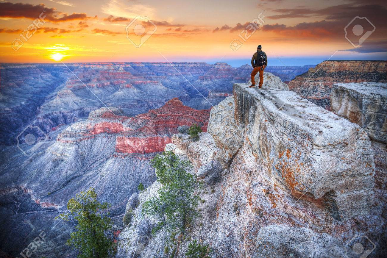 man in the Grand Canyon at sunrise. tourist in America - 55376975