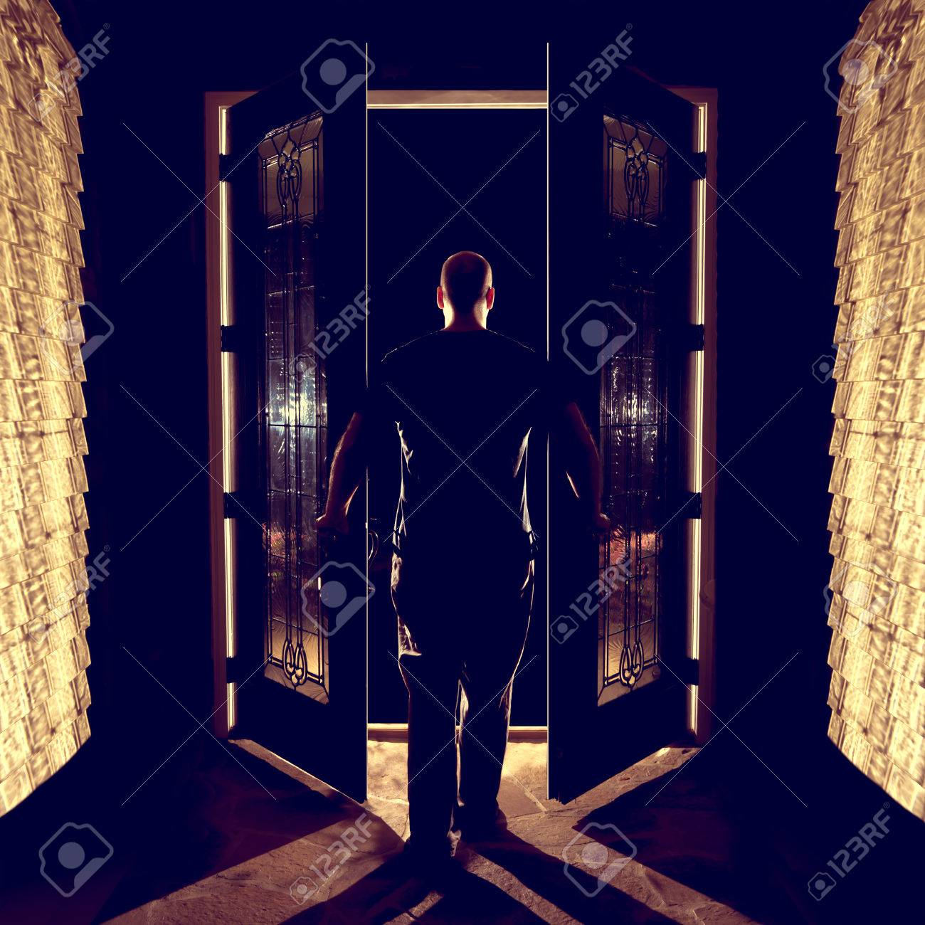 Man Opening Closing Front Double Entryway Doors With Glass In ...