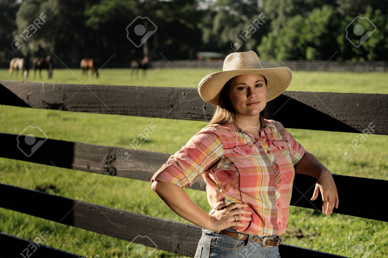 7e1371fc1 Cowgirl lady woman female wearing cowboy hat and flannel shirt..