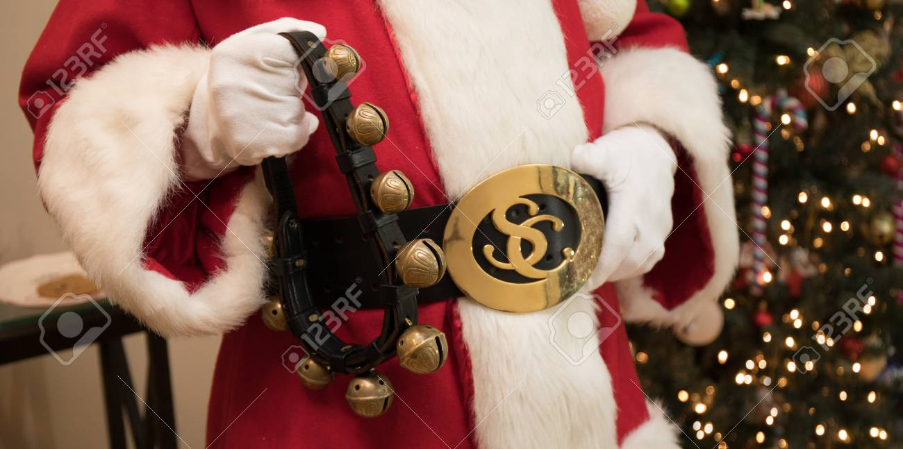31ff5bfb0c1 A close up photo of Santa's belly holding his belt and sleigh bells. Stock  Photo