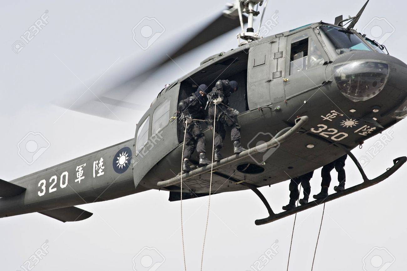 Taiwan Airborne special forces rope-descending from helicopter
