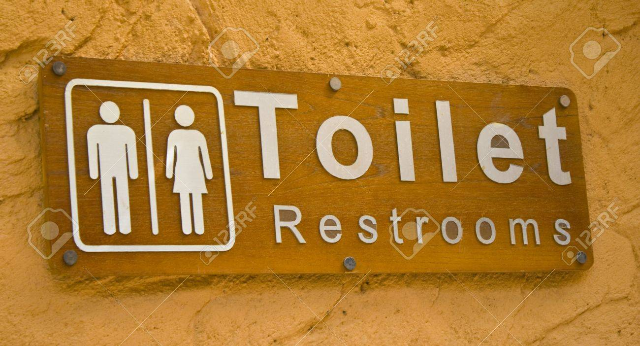 Wooden toilet sign with orage background, and wood background. Stock Photo - 5568169