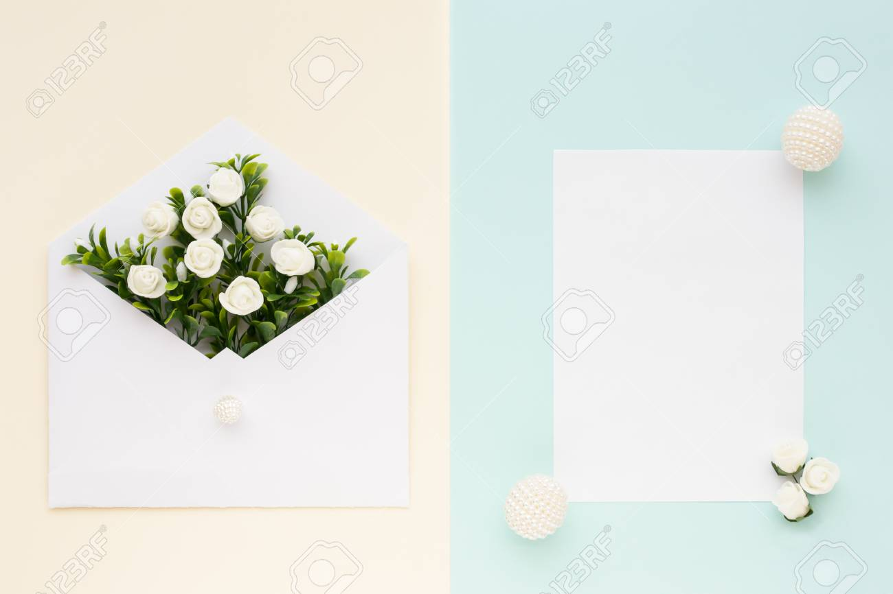 Workspace. Wedding Invitation Card, Envelope, White Roses And ...