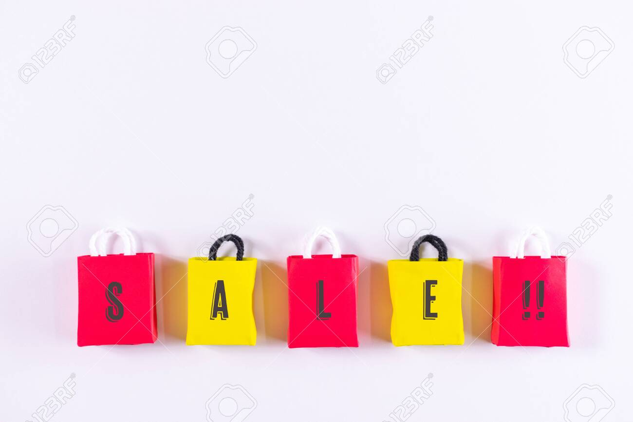 Black Friday paper shopping bag on white table, Top view. concept about of retail consumers and shoppers looking for bargains and low prices or seasonal discounts and promotions. - 134734055