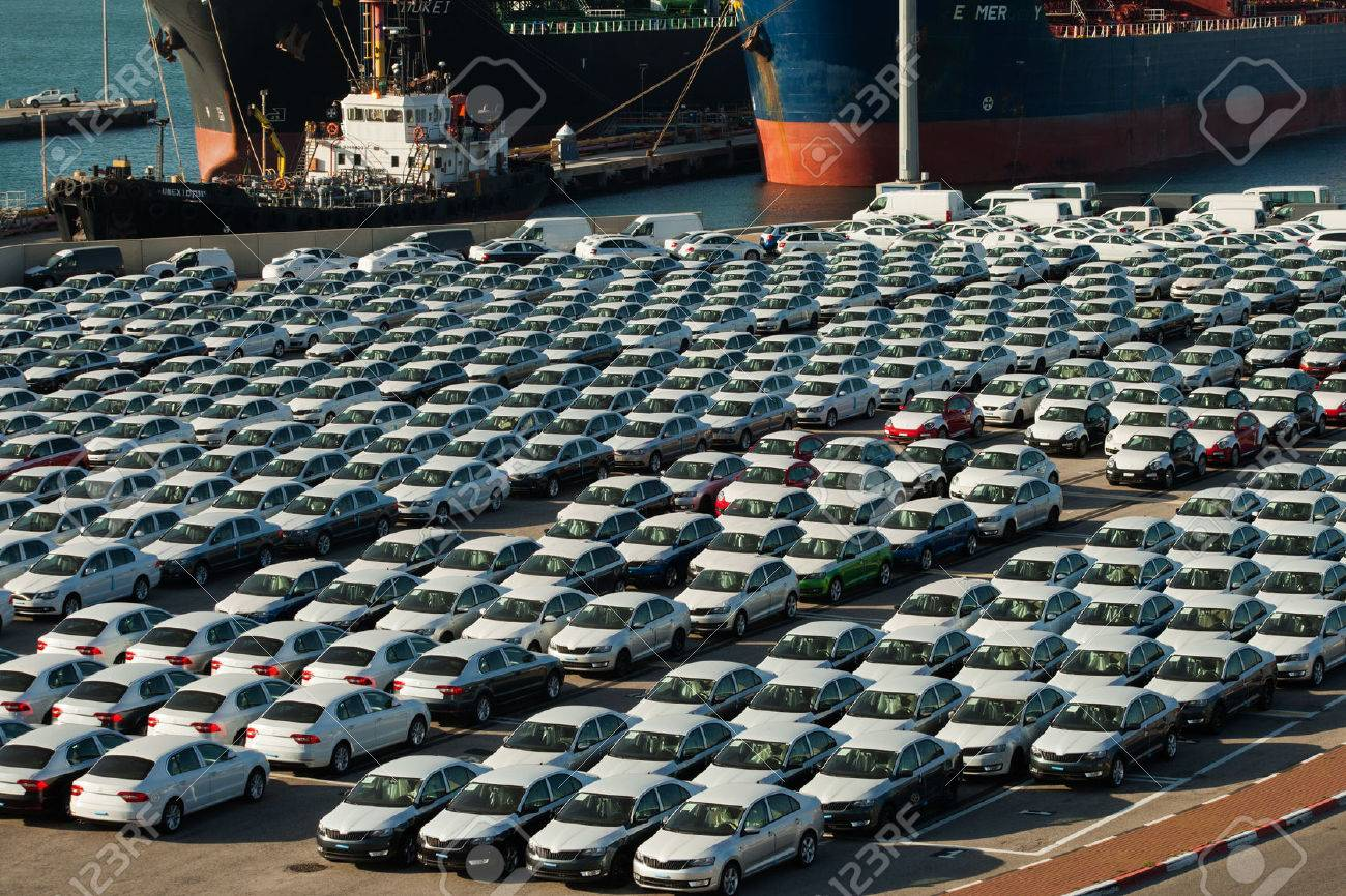 Rows Of New Cars Parked In An International Port Stock Photo