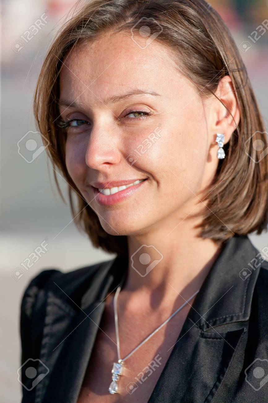 Portrait of beautiful businesswoman posing for camera outdoor Stock Photo - 19062962