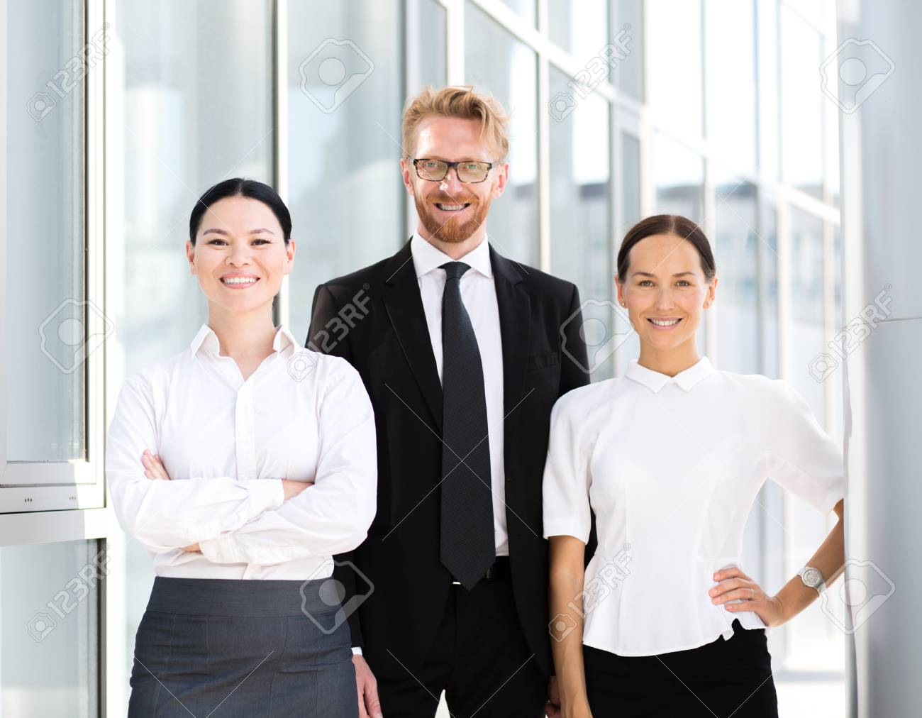 Group Of Businesspeople Standing Together Man In Business Suit
