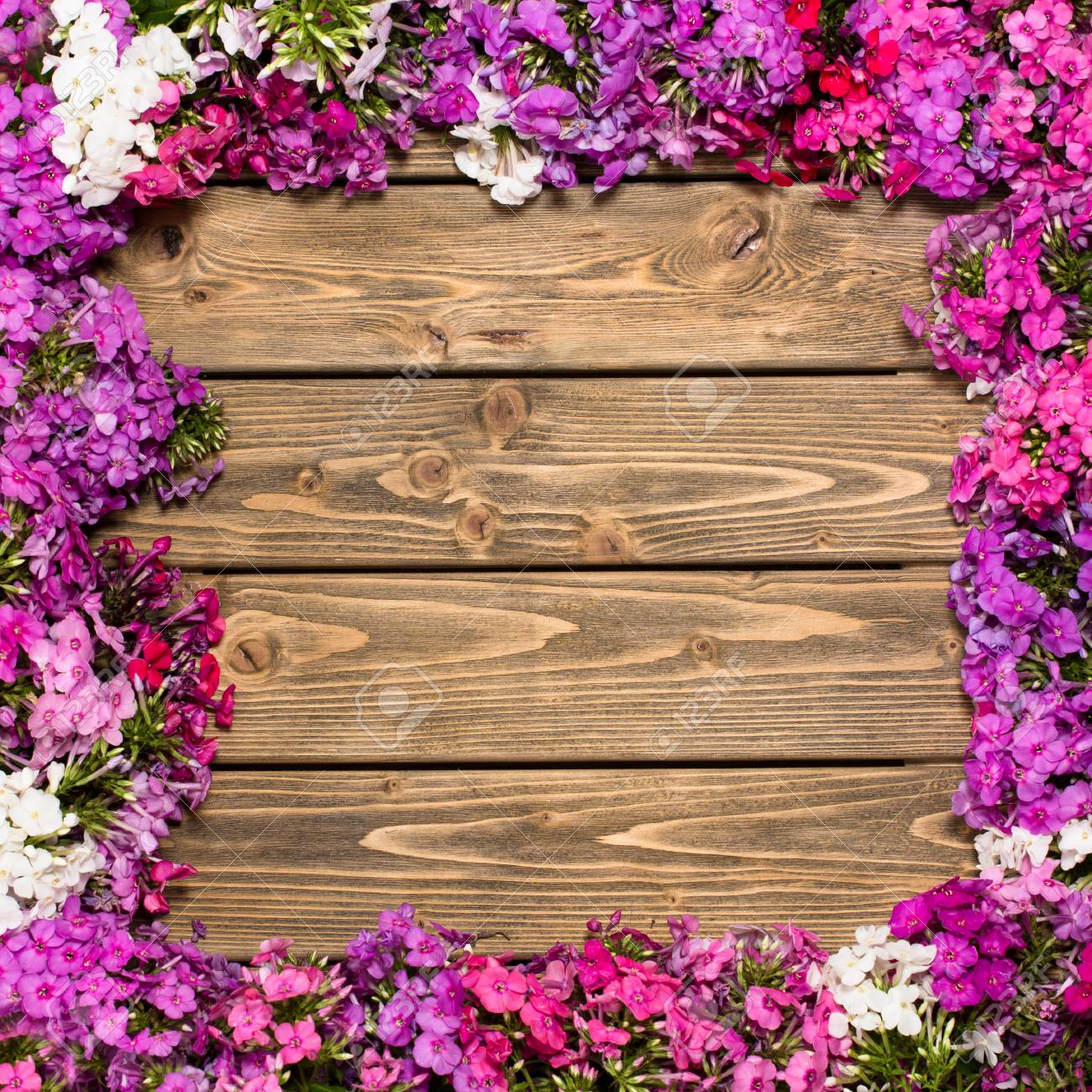 Beautiful Frame Of Lilac Flowers Isolated On Wooden Background