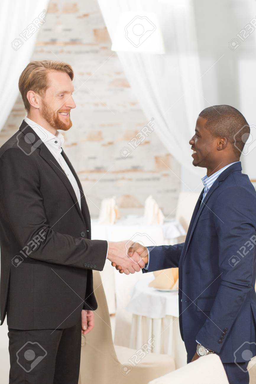 Business People Shaking Hands And Standing Face To Face Two Stock