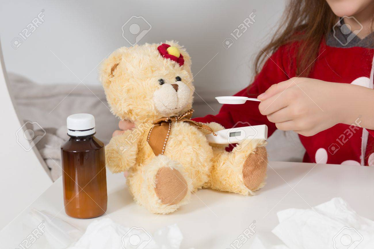 Fever cold and flu concepts close up of teddy bear and medicines fever cold and flu concepts close up of teddy bear and medicines altavistaventures Images