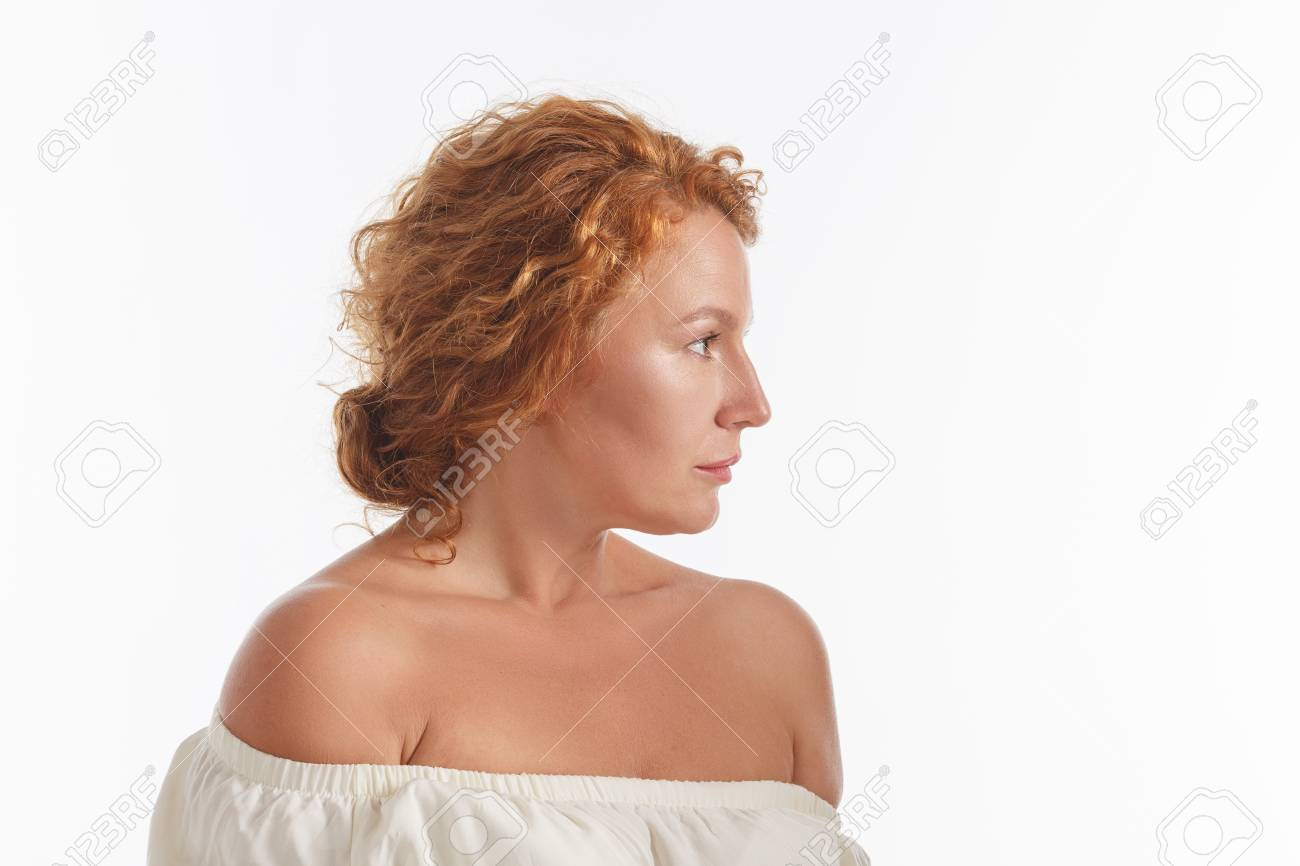 Beautiful red haired mature of senior lady looking serious isolated on white.  Stock Photo -