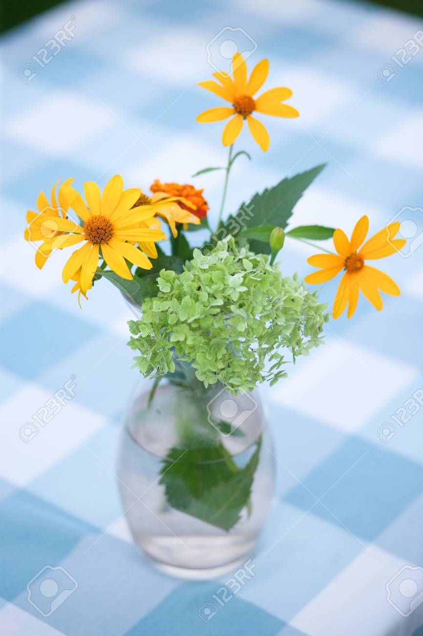 Closeup Picture Of Beautiful Vase With Yellow Flowers In Outdoors