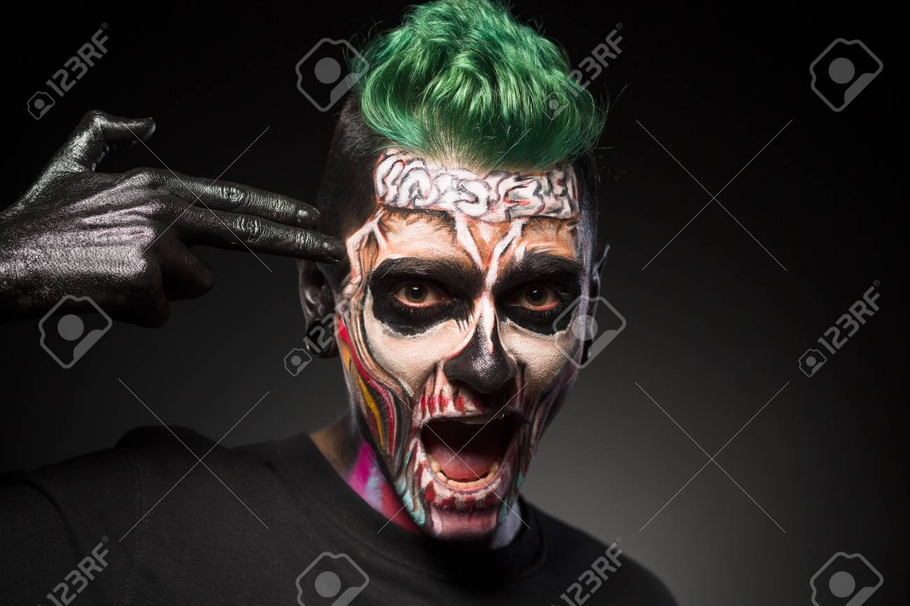 Halloween Make Up Skelet.Halloween Makeup Man With Skeleton Colored Face Touching Temple