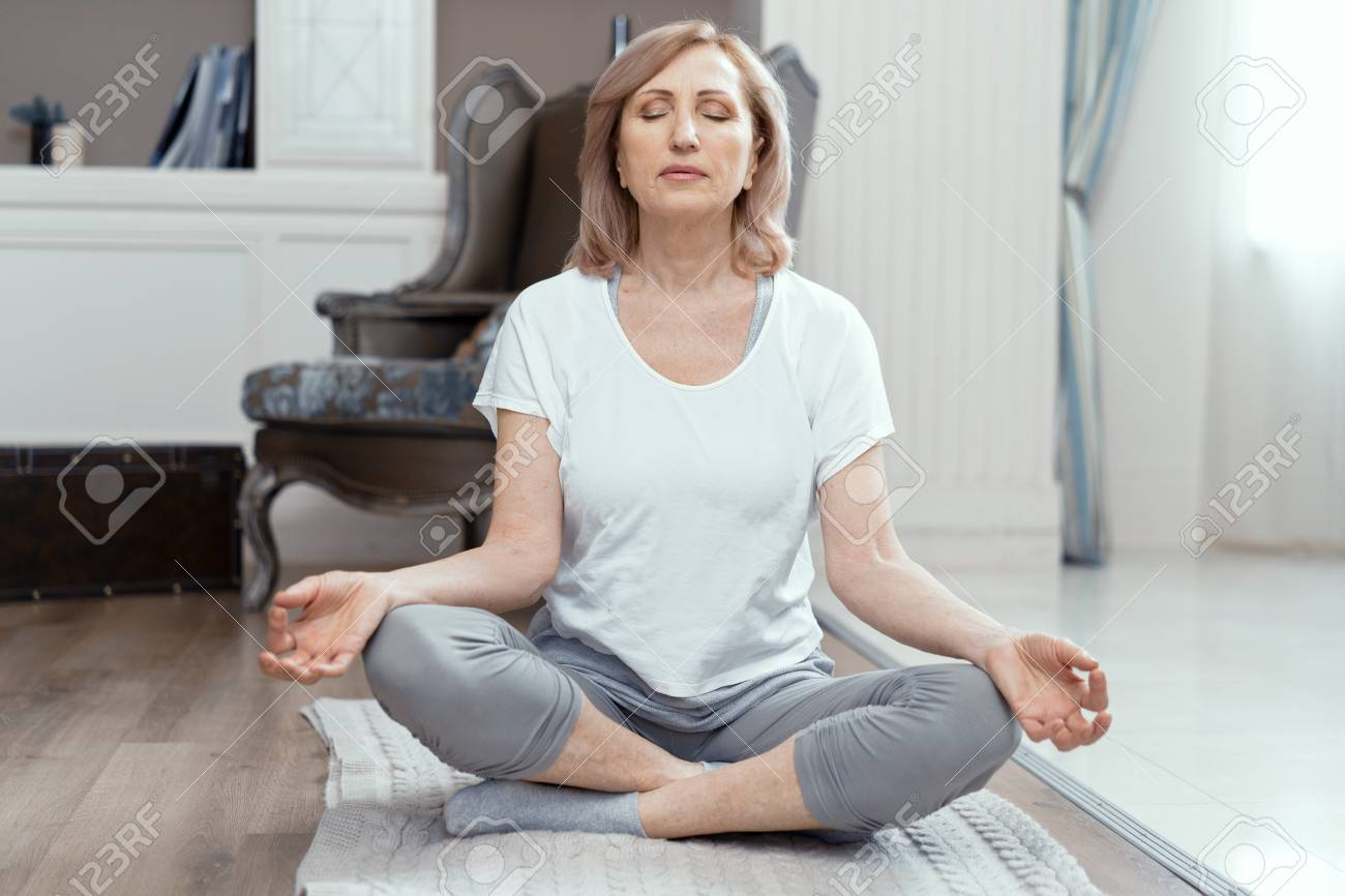 A Woman Takes Yoga At Home Woman Over 50 Years Old She Took Stock Photo Picture And Royalty Free Image Image 119684948