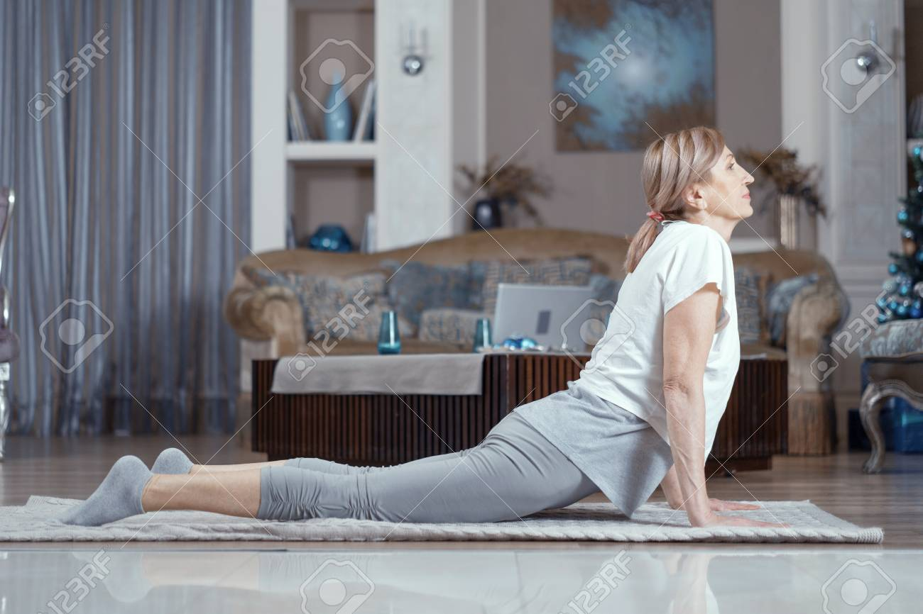 Yoga Classes For Women Over 50 Years A Woman Is Engaged At Home Stock Photo Picture And Royalty Free Image Image 119684963