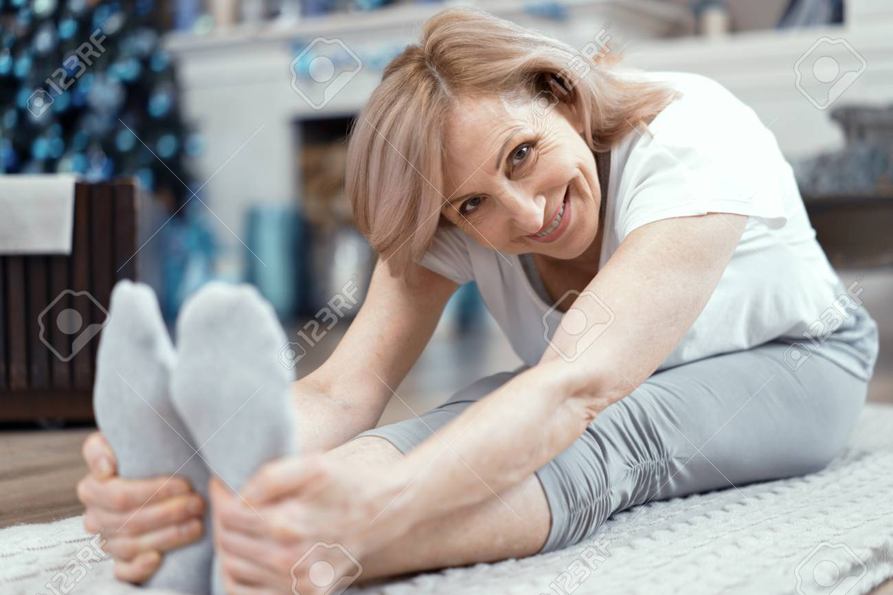 A Woman Over 50 Years Old Enjoys Yoga She Took The Position Stock Photo Picture And Royalty Free Image Image 119686205