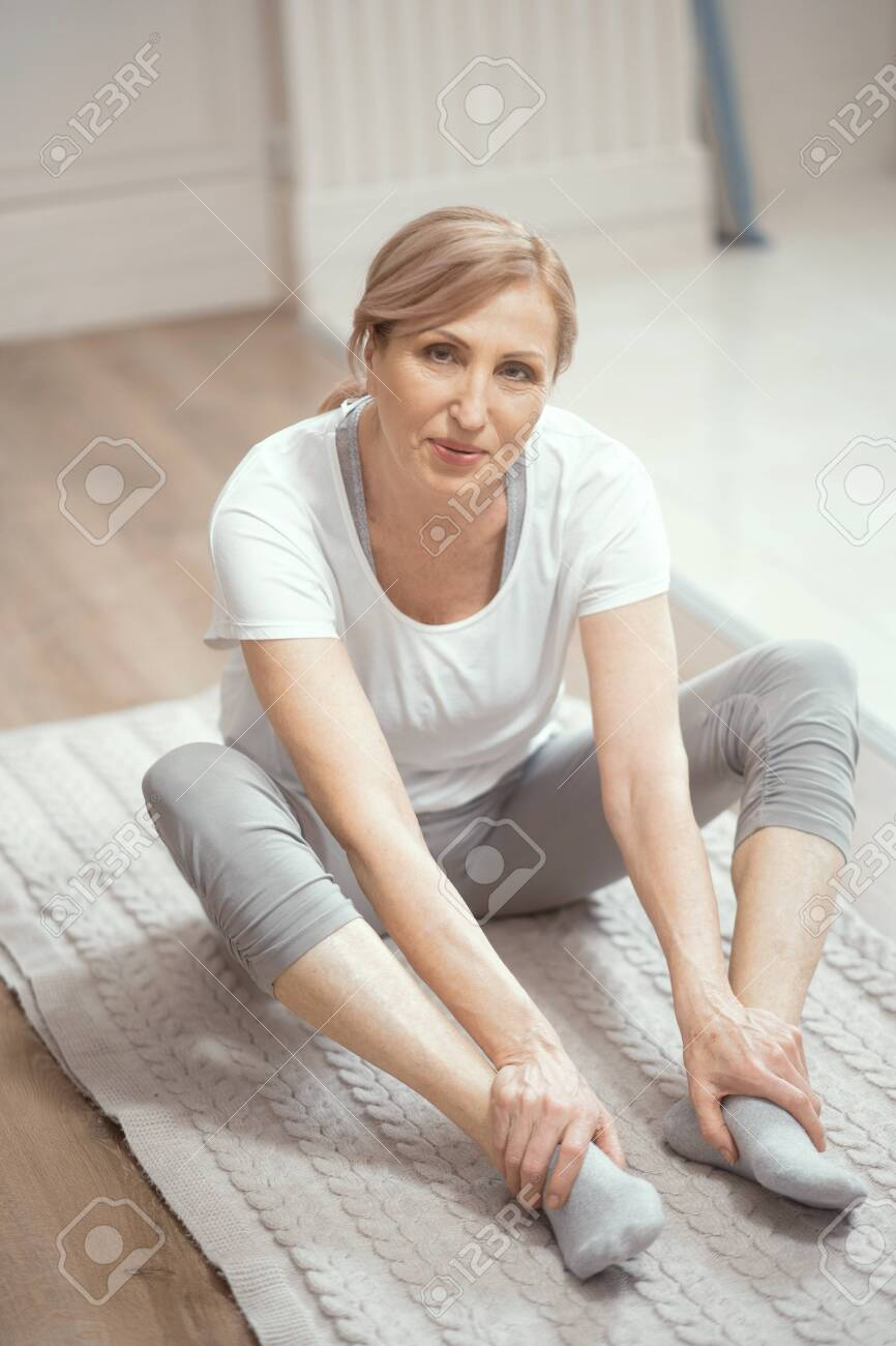 European Looking Woman Over 50 Years Old Doing Yoga At Home In Stock Photo Picture And Royalty Free Image Image 119686219