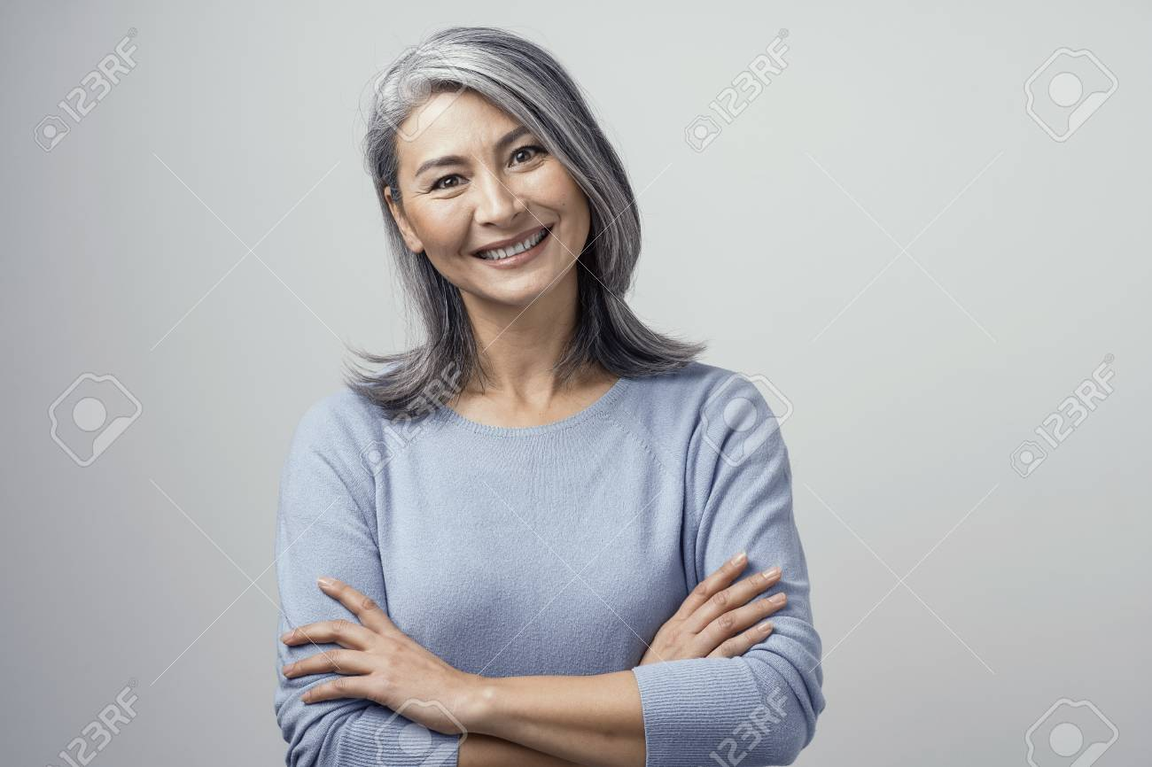 Mature asian ladies pictures Attractive Optimistic Grey Haired Mature Asian Woman Smiles Widely In Studio And Crosses Her Hands Head Tilted Hands And Shoulders Tonned Portrait On White Background Stock Photo Picture And Royalty Free Image Image