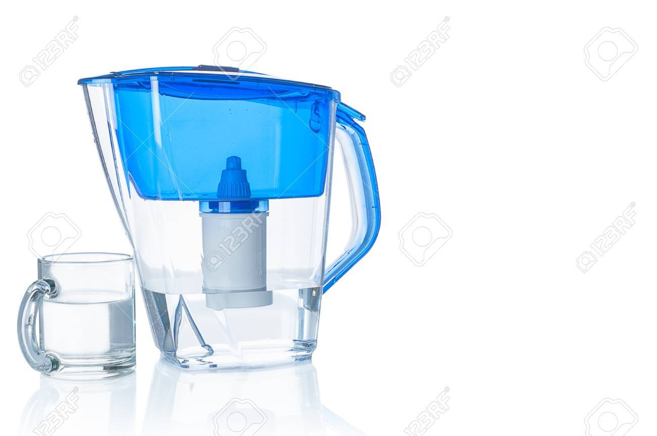 Water filter pitcher and glass on white background - 54582086