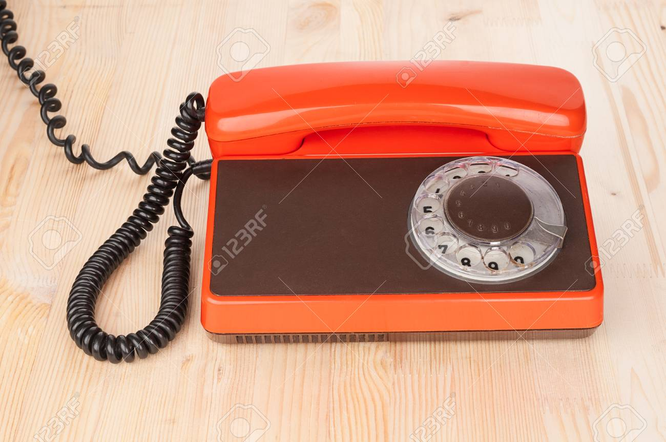 Orange antique phone on wooden desk Stock Photo - 54827939 - Orange Antique Phone On Wooden Desk Stock Photo, Picture And Royalty