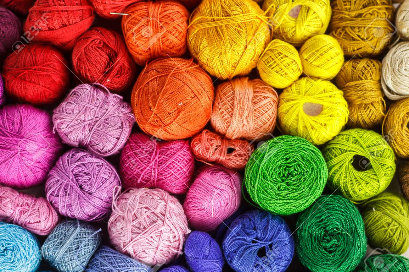 Rainbow-colored yarn balls, viewed from above. - 104104901