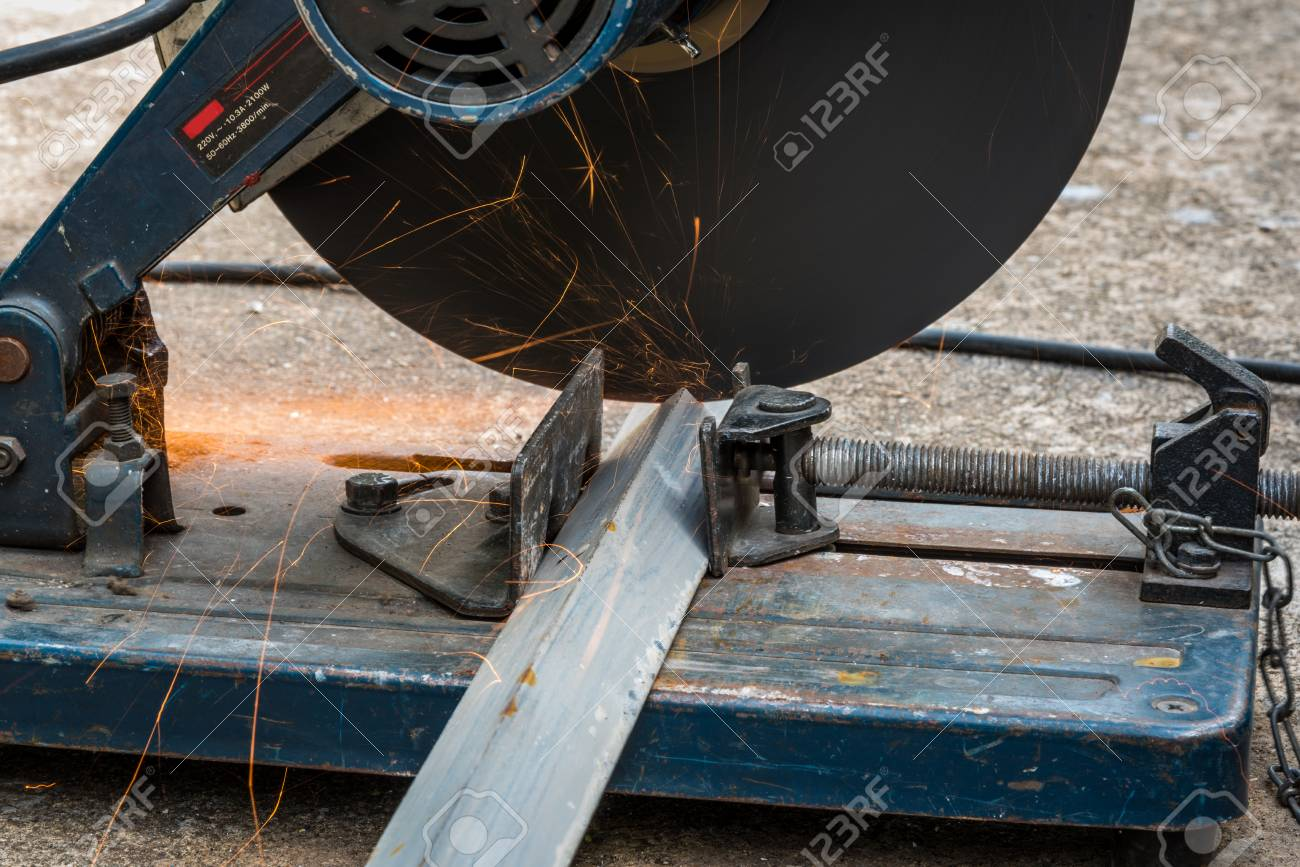 Cutting a triangle metal and steel with compound mitre saw with cutting a triangle metal and steel with compound mitre saw with circular blade stock photo keyboard keysfo Image collections