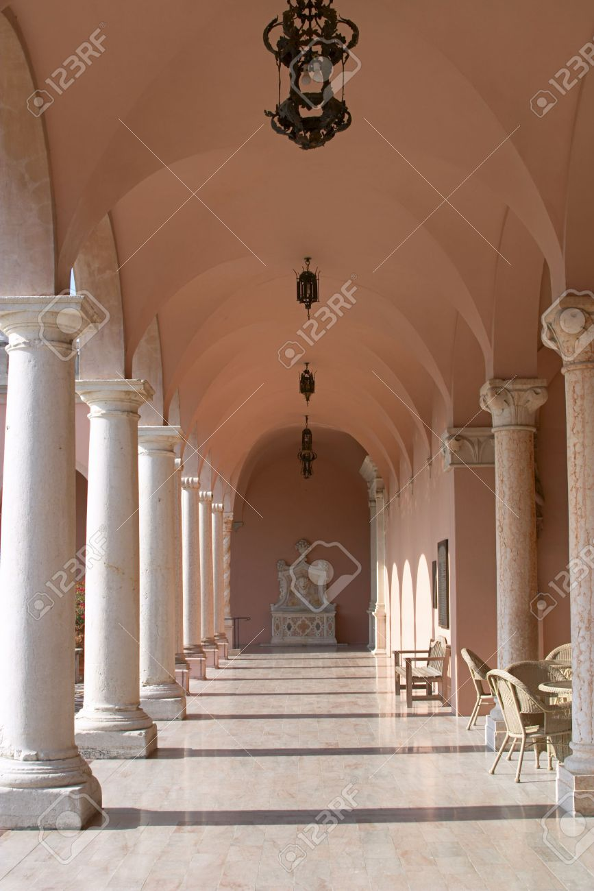 Venetian Style view down a hallway in a pink marble, venetian style palazzo