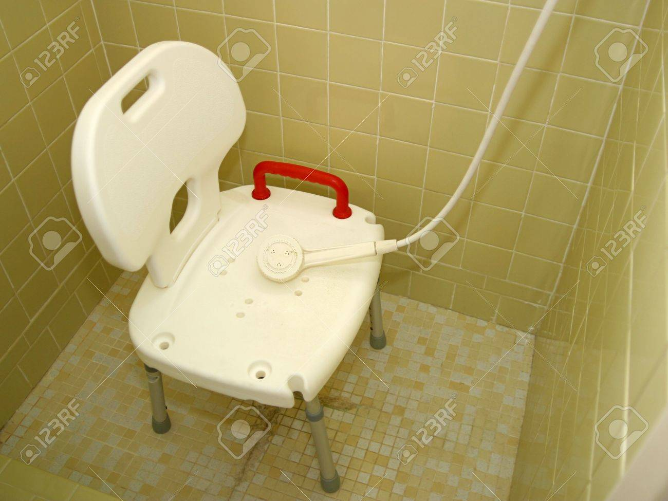 A Medical Shower Chair And Spray Shower Head For Injured Or Disabled