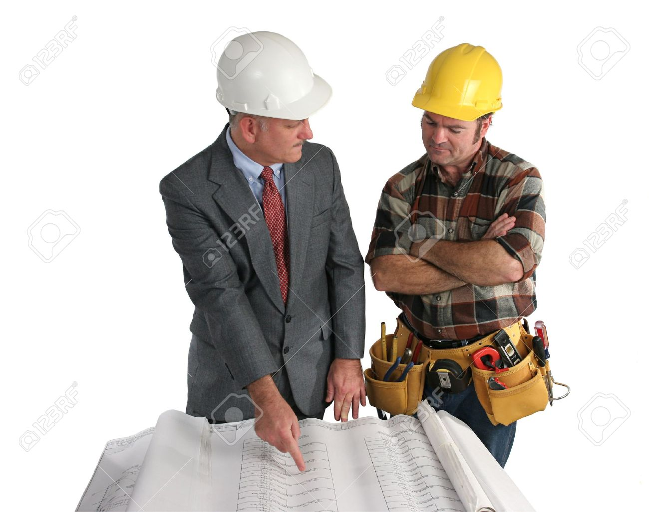 an engineer explaining the blueprints to a construction foreman - isolated Stock Photo - 235734