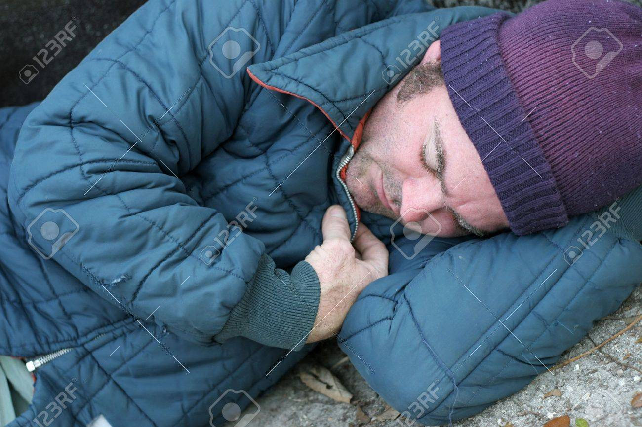 6e8f7671a2 A closeup view of a homeless man sleeping on the ground. Stock Photo -  1406738