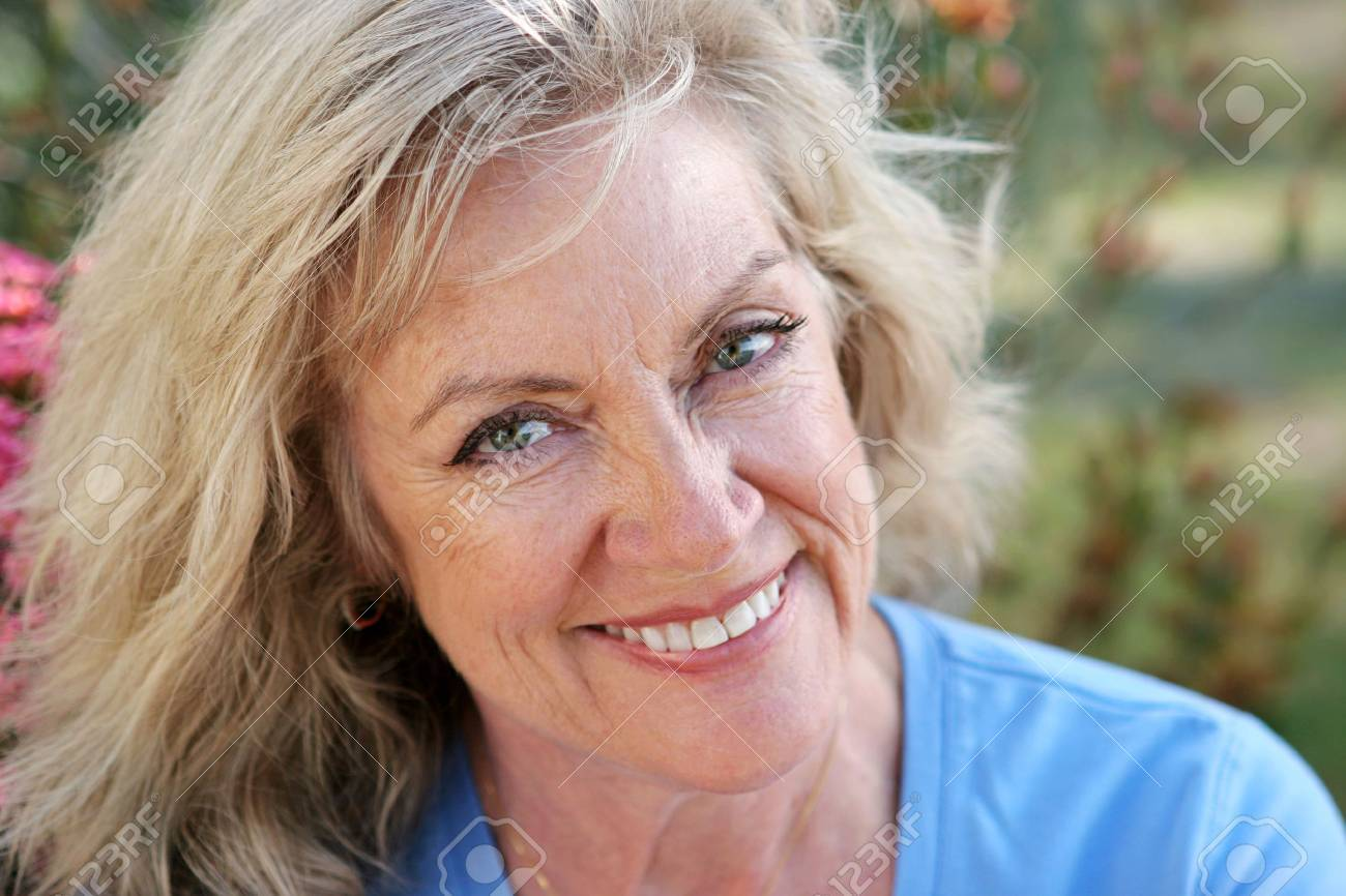A beautiful mature woman smiling with perfect teeth. Horizontal orientation. Stock Photo - 445928