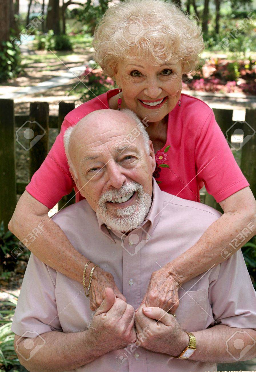 A happy senior couple embracing outdoors.  They are still in love after many years together. Stock Photo - 460976