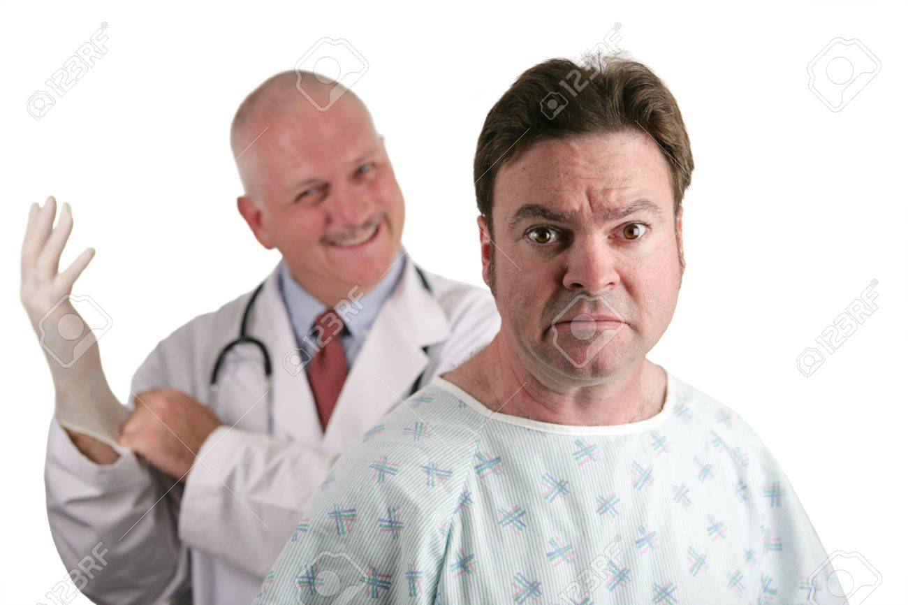 A nervous looking patient about to get his first prostate exam.  The doctor is in the background putting on his rubber glove.  Shallow DOF with focus on the patient's face. Stock Photo - 539850