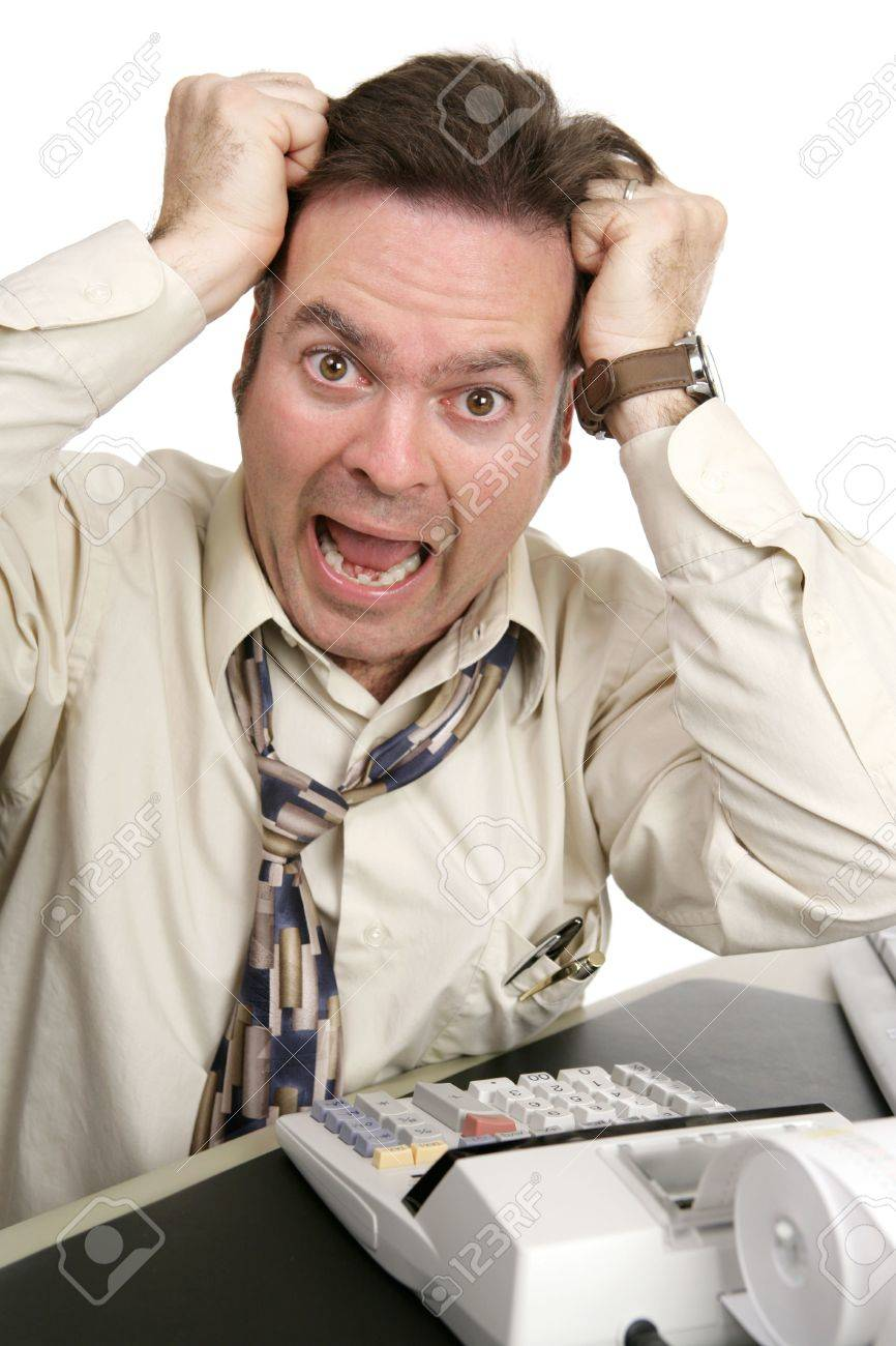 A man going crazy trying to do his own taxes.  Isolated on white. Stock Photo - 766838