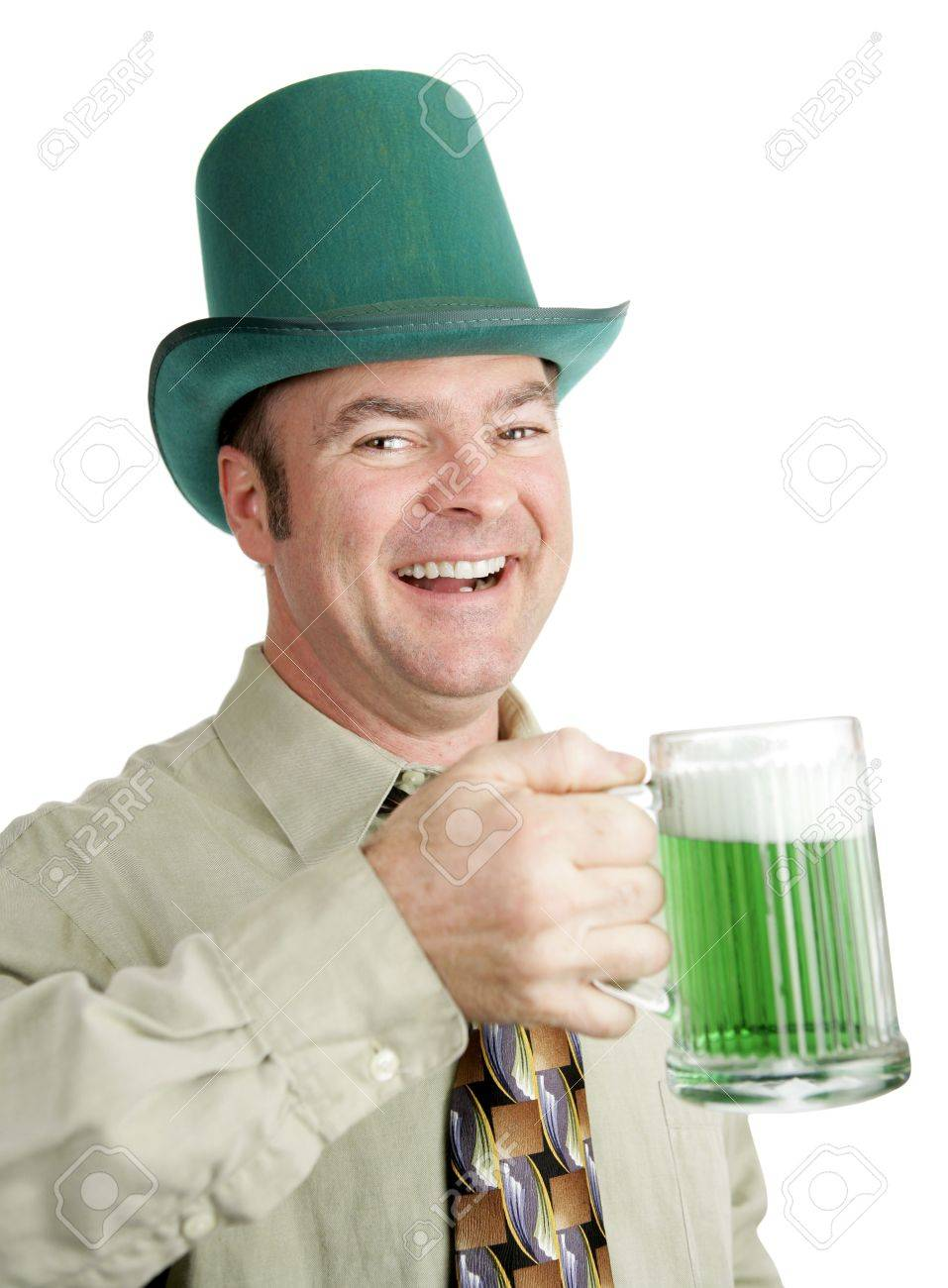 Man of Irish heritage enjoying a green beer on St. Patrick's Day and singing a drinking song.  Isolated on white. Stock Photo - 2348726