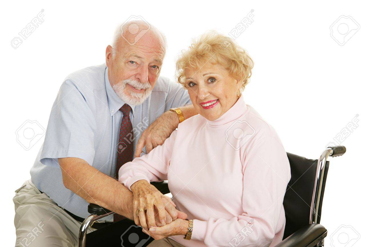 Attractive senior couple - the wife is in a wheelchair.  Isolated on white. Stock Photo - 2483076