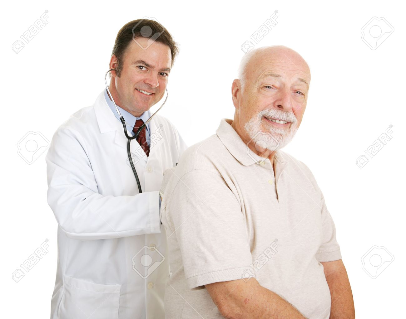 Doctor listening to a senior man's lungs.  Both smiling at camera.  Isolated. Stock Photo - 2576463