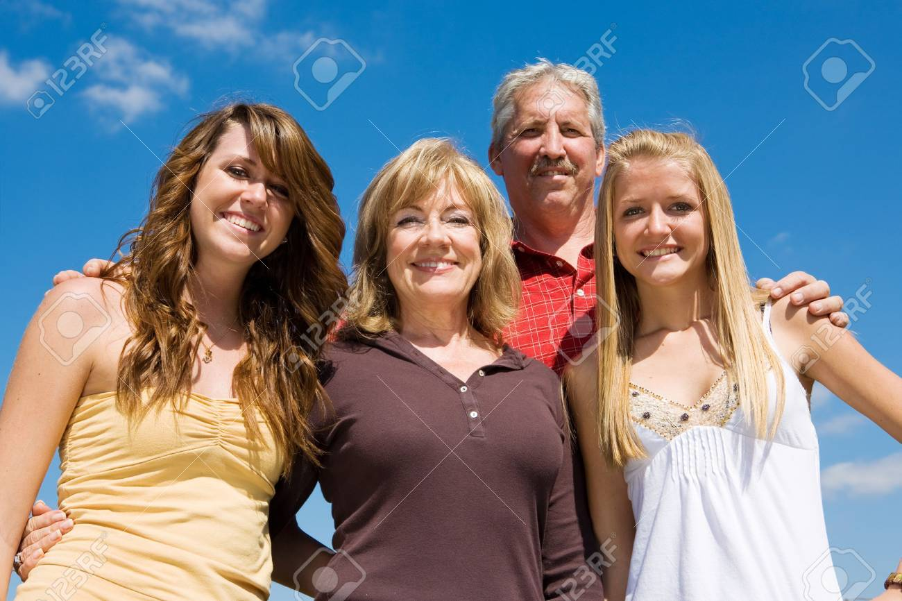 Beautiful family of grandparents and granddaughters against a blue sky. Stock Photo - 2701950