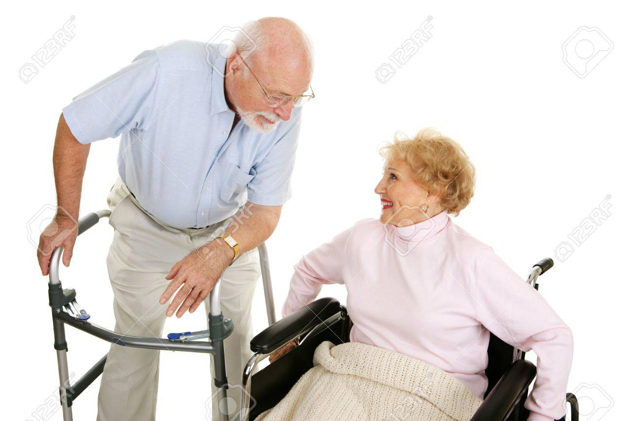 Senior man in walker flirting with a senior lady in a wheelchair.  Isolated on white. Stock Photo - 2870378