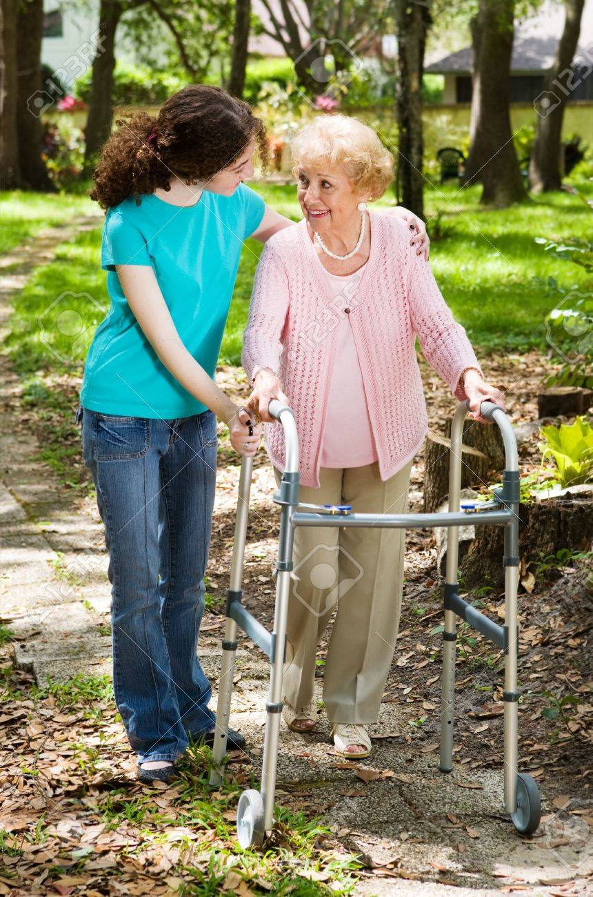 Senior woman and her teen granddaughter taking a walk in the park. Stock Photo - 3051278